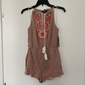Romper with embroidered detail and tassels!